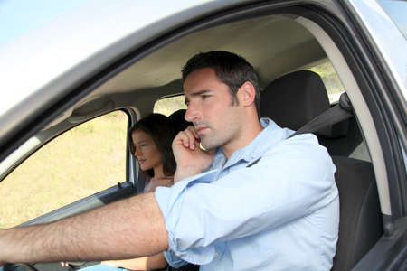 reckless: Man talking on mobilephone while driving