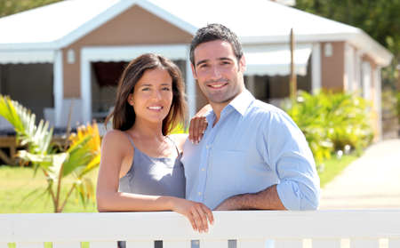 realty residence: Couple standing in front of new home