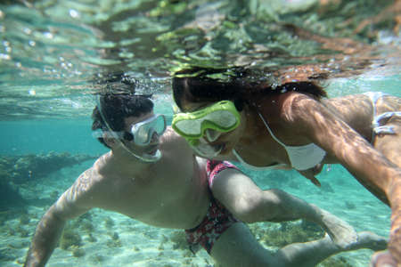 Couple snorkeling in Caribbean waters photo