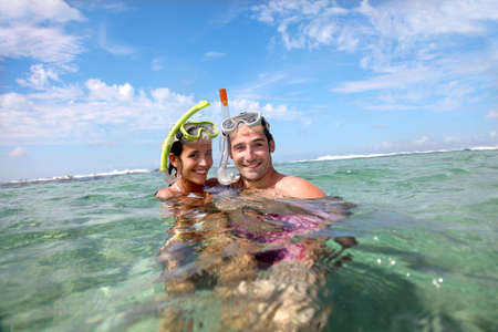 snorkelling: Portrait of happy couple doing snorkeling
