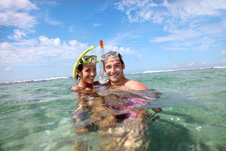 snorkelling: Portrait of happy couple doing snorkeling