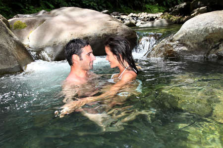 Couple having a bath in fresh river water Stock Photo - 13123892