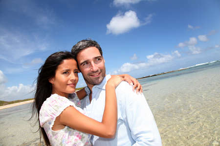 antilles: Couple of lovers embracing each other at the beach