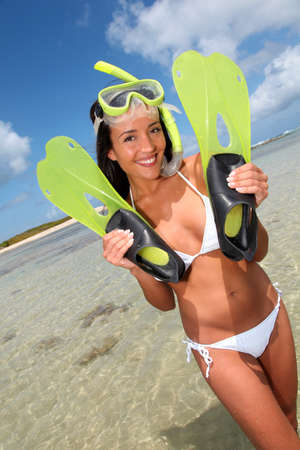 Closeup of smiling woman with diving mask and flippers photo