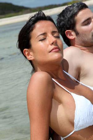 suntanning: Closeup of woman relaxing in lagoon water