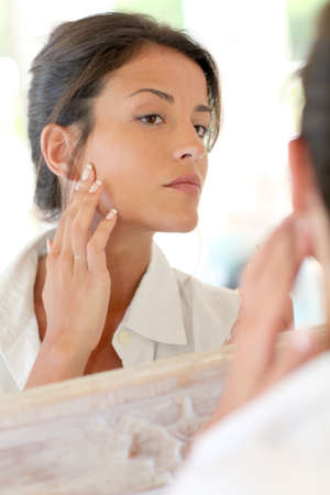 Portrait of woman applying foundation makeup on her face Stock Photo - 13122763