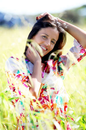 Beautiful woman in country field