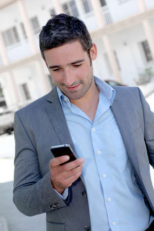 out in town: Businessman using mobilephone out in town