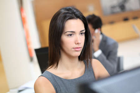 Woman working in office in front of desktop computer Stock Photo - 13258270