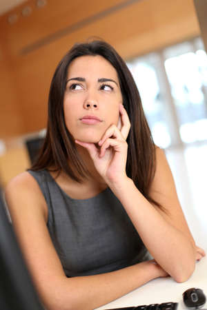 Office worker with upset look on her face Stock Photo - 13258265