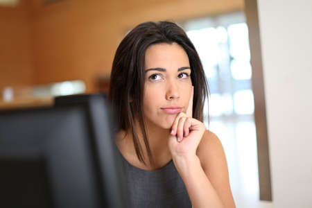 questioning: Office worker with interrogative look on her face