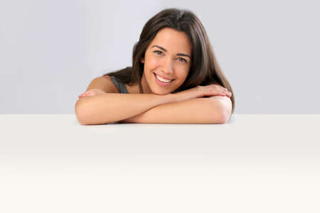 Smiling young woman on white background Stock Photo - 13258218