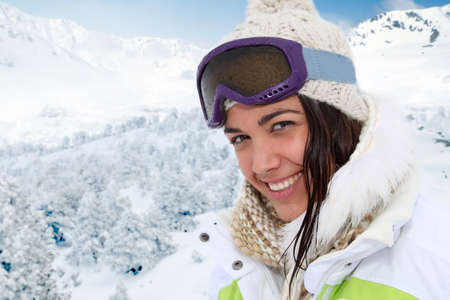 Portrait of woman at the mountain in ski outfit photo