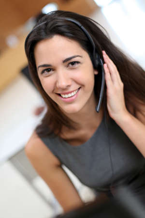 Portrait of smiling receptionist with headphones Stock Photo - 13757436