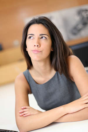 officeworker: Portrait of office-worker with thoughtful look