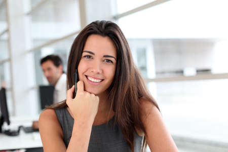 saleswoman: Young woman working in office