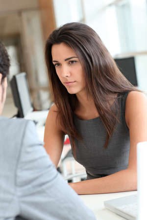 Young woman being interviewed for a job position photo