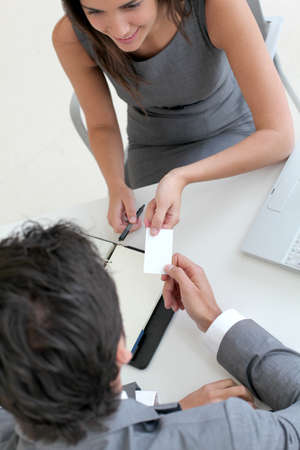 exchanging: Upper view of hands holding business card