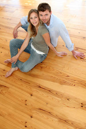 Couple at home relaxing on the floor photo