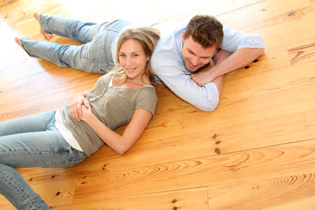 wooden floors: Couple at home relaxing on the floor