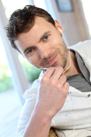 handsfree phone: Young man talking on mobile phone with handsfree microphone Stock Photo