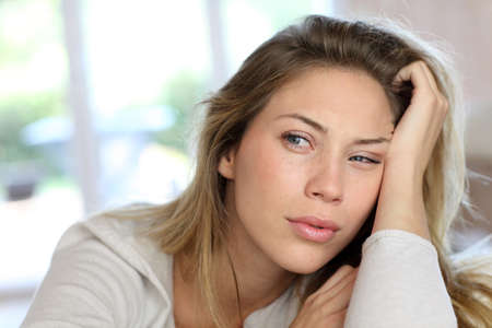 Portrait of blond woman with boring look photo