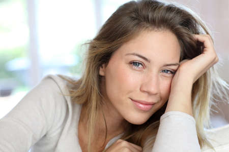 charming girl: Beautiful young woman with blue eyes Stock Photo
