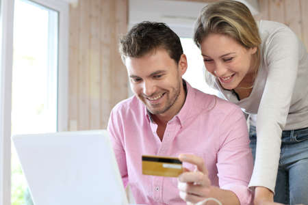 online shopping: Couple using credit card to shop online