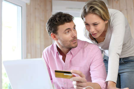 secured payment: Couple using credit card to shop online