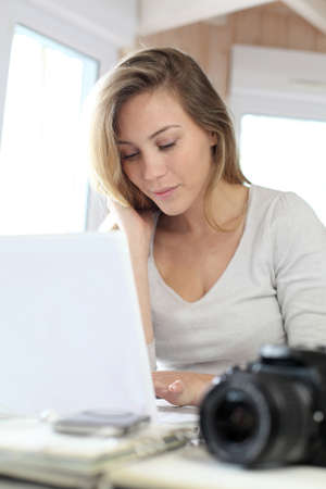 telework: Woman working at home on laptop computer