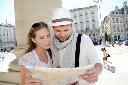 touristic: Couple holding a touristic map of Bordeaux Stock Photo