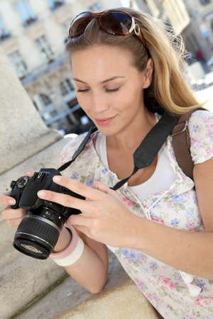 Portrait of young tourist looking at camera screen photo