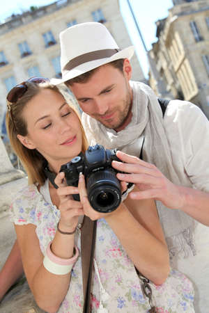 Couple enjoying taking pictures while visiting city Stock Photo - 13808414