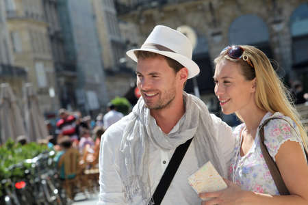 cultural clothing: Young couple visiting city in summertime