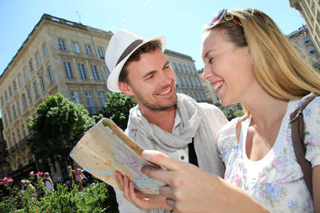 vacation map: Couple of tourists looking at city tour map  Stock Photo