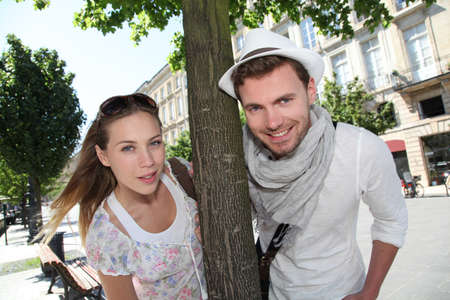 french culture: Couple standing by a tree in town