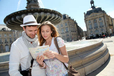 aquitaine: Couple standing by a fountain in Bordeaux with map