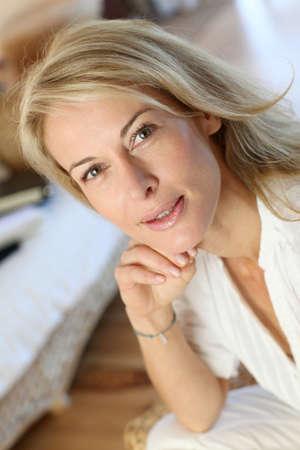 Blonde mature on sofa