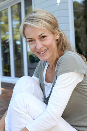 Portrait of smiling mature woman relaxing outside