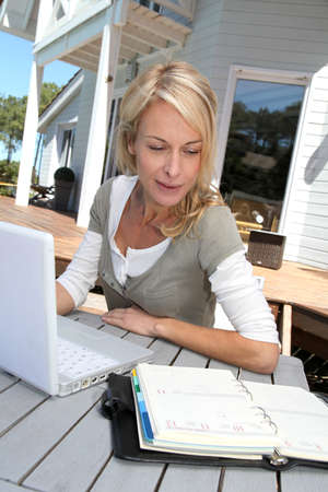 teleworker: Teleworker in front of latptop computer at home Stock Photo