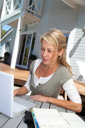 Teleworker in front of latptop computer at home photo