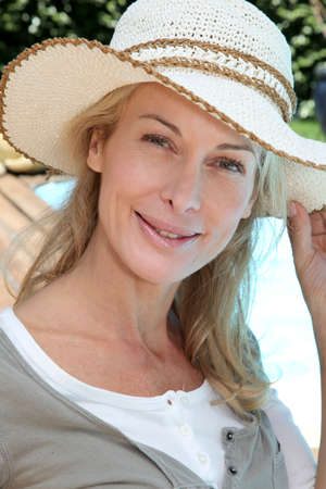 Portrait of smiling mature woman relaxing outside photo