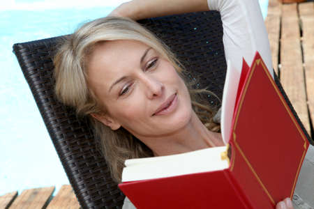 40 years old: Portrait of woman reading book outside Stock Photo