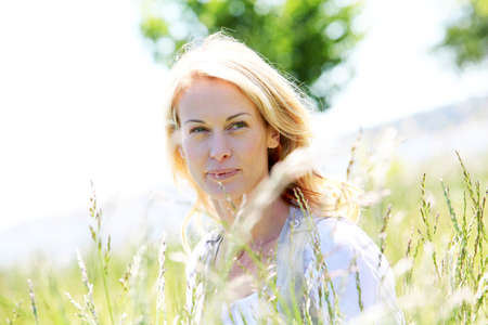 nude blonde woman: beautiful woman standing in country field in summer time