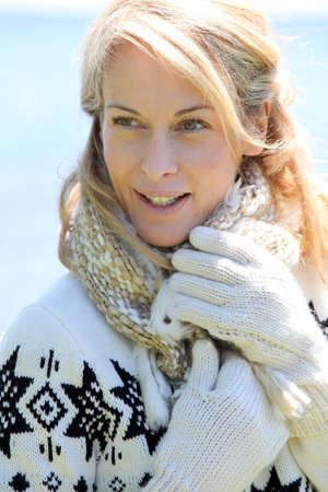 Portrait of middle-aged woman in winter at the beach Imagens