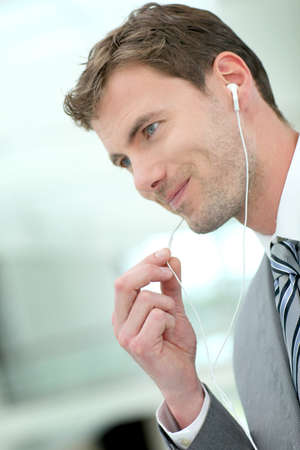 Portrait of businessman talking on the phone with handfree headset Stock Photo - 13904731