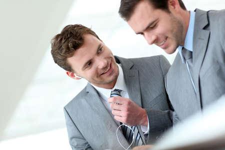 Business partners working in hallway with electronic tablet Zdjęcie Seryjne - 13905065