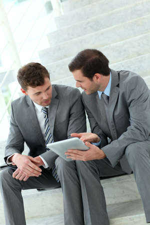 Business meeting in stairs with electronic tablet Stock Photo - 13905200