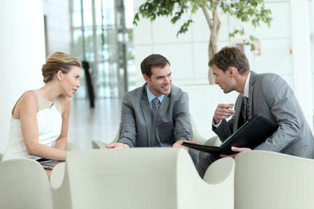 business lounge: Business people meeting in airport lounge