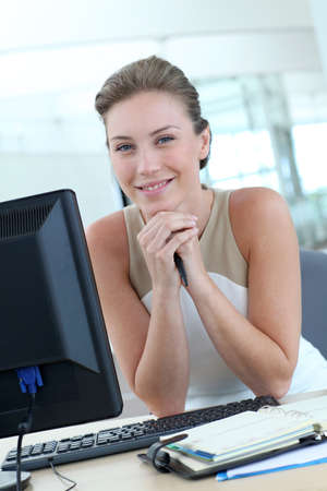 officeworker: Beautiful blond office-worker sitting at her desk